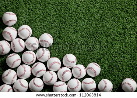 Lots of baseballs on green turf background