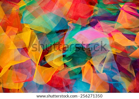 Lots of bright messy colorful clothing, abstract background - stock photo