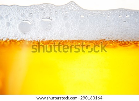 lots of bubbles floating in a drink with froth - stock photo