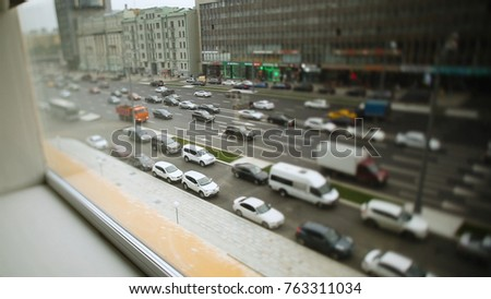 Lots of cars parking in the city. Footage. Roads are crowded with cars. Rapid modern urban life