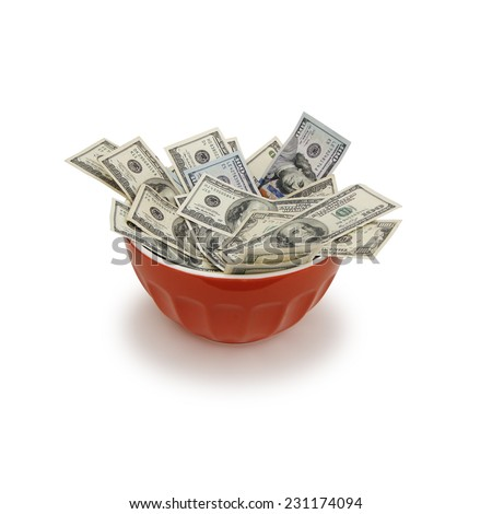 Lots Of Cold Cash In A Warm Colored Bowl Over A White Background. - stock photo