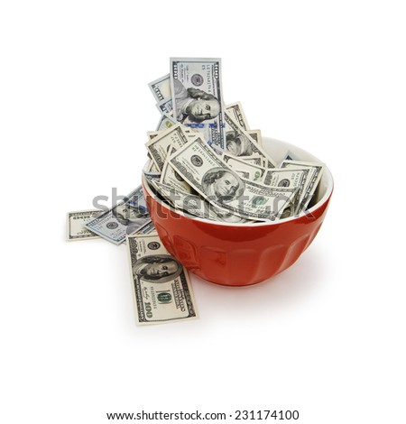 Lots Of Cold Cash In A Warm Colored Bowl Over A White Background.