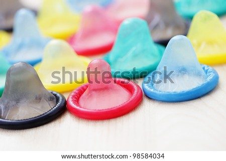 lots of colorful condoms - healthcare and medicine - stock photo