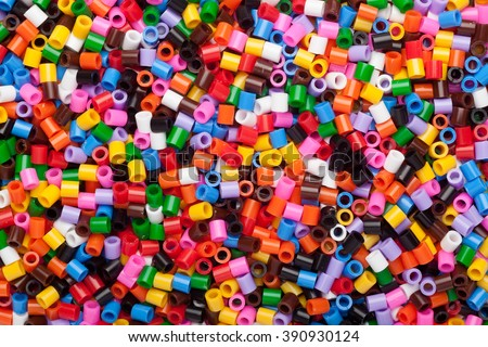 Lots of colorful fusible plastic beads used for arts and craft - stock photo