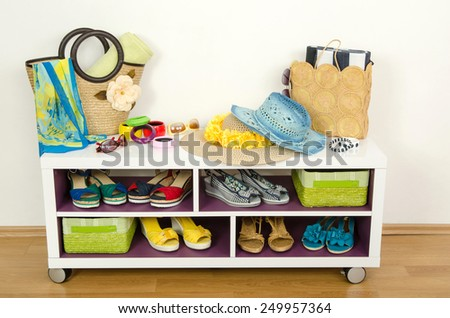 Lots of colorful summer accessories on a shelf. Bags, jewelry, shoes and sandals nicely arranged on a shelf