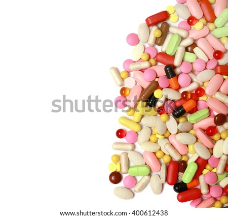 Lots of colorful tablets and pills, medical background. Macro. Isolated on white background.