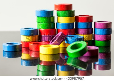 Lots of colorful toy rings with reflections, concept business and finance