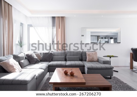 Lots of decorative cushions on comfortable corner sofa - stock photo