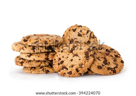 Lots of delicious freshly baked crunchy homemade chocolate chip cookies isolated on white with copyspace - stock photo