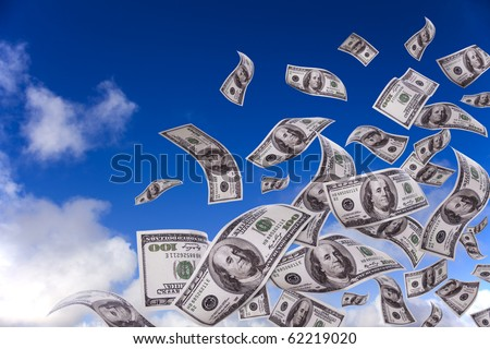 lots of dollar bills falling from the sky - stock photo