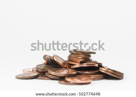 Lots of euro cent coins on a white background.