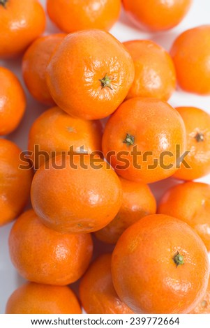 lots of fresh orange on a white background