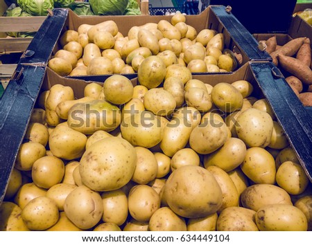 Lots Of Fresh Organic Bio Potatoes In Crate With Other Vegetables Next To Them