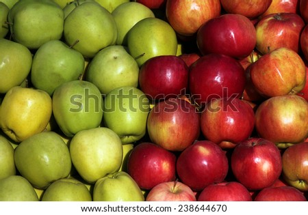 Lots of green and red apples with focus on middle apple. - stock photo