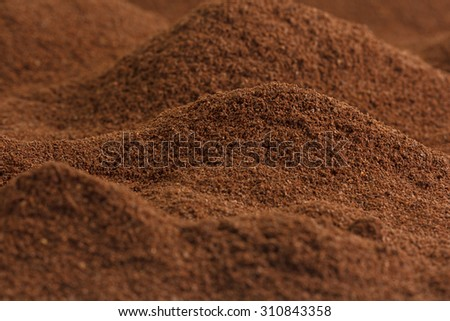 Lots of ground coffee looking like valleys and mountains - stock photo