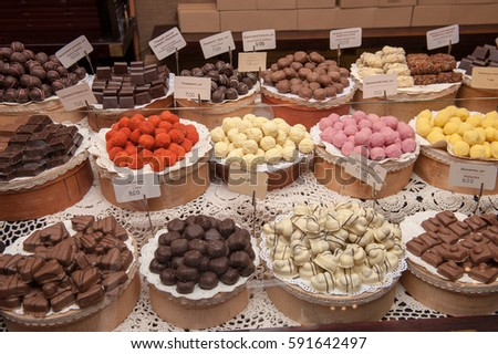 Lots of handmade chocolate sweets on plates in one of the shops in Lviv, Ukraine.