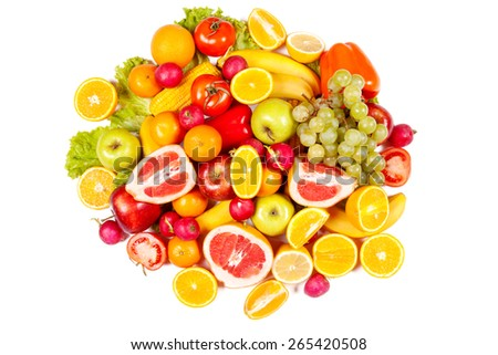 Lots of juicy ripe fruit and vegetables on a white background - stock photo