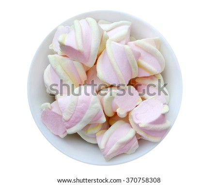 Lots of little white and pink marshmallows in a cup isolated on white - stock photo