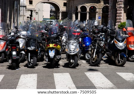 Lots of motorcycles in a city. Italy. - stock photo
