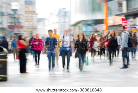 Lots of people, tourists and Londoners  walking via Leicester square, Blur background - stock photo