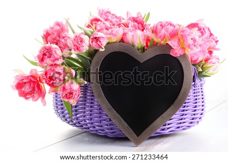 lots of pink tulips with heart - flowers and plants - stock photo