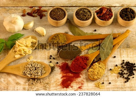 lots of powder spices on a wooden table - stock photo