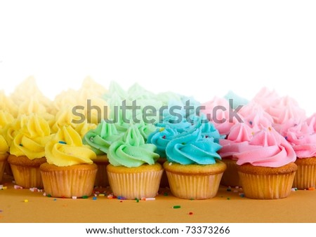 lots of rainbow cupcakes - room for copy