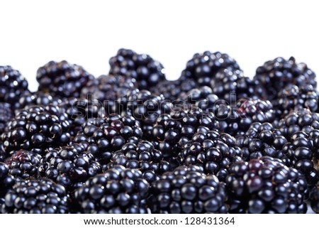 Lots of ripe blackberries - closeup, on white background