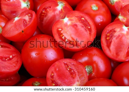Lots of ripe tomatoes background - stock photo