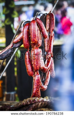 lots of sausages and chorizos in a medieval fair - stock photo