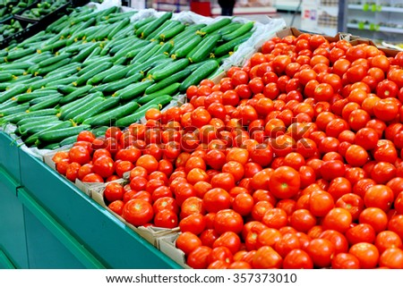 lots of tomatoes in the store - stock photo