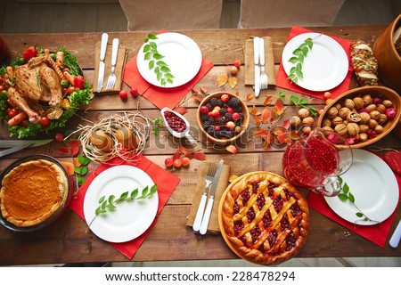 Lots of traditional festive food on wooden table - stock photo