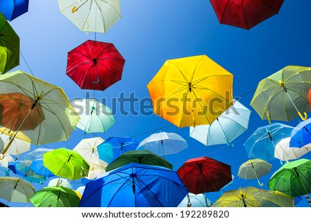 Lots of umbrellas coloring the sky in the city of Pai, Thailand - stock photo