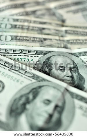 lots of 100 US dollar bills in a line. - stock photo