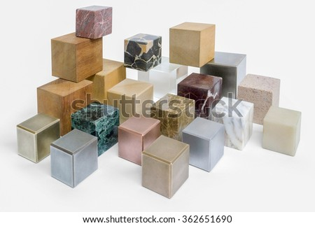 lots of various cubes made of different materials in white back - stock photo