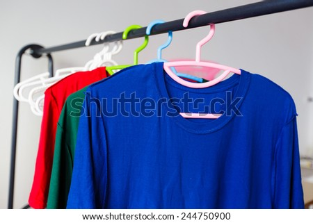 Lots of washing clothes on hangers - stock photo