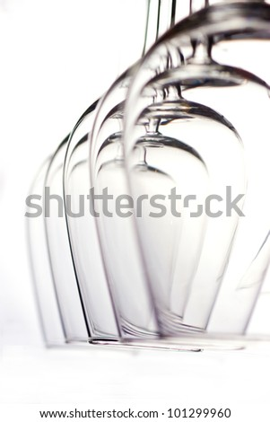 Lots of wine glasses on the white - stock photo