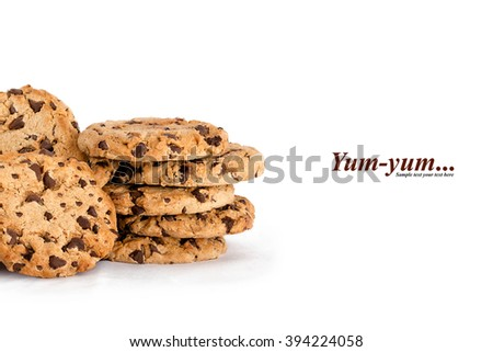Lots of yummy freshly baked crunchy homemade chocolate chip cookies isolated on white with copyspace and text - Yum-yum - stock photo