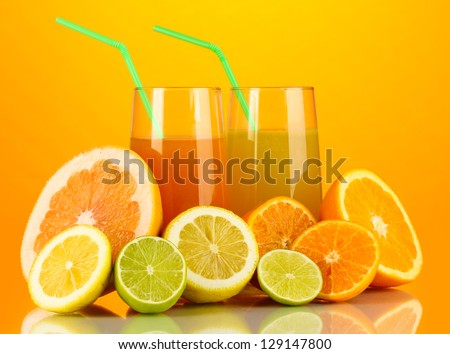Lots ripe citrus with juices on orange background