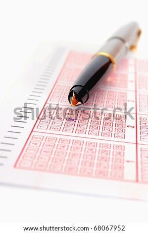 Lottery and pen - stock photo