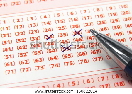 lottery ticket and pen - stock photo