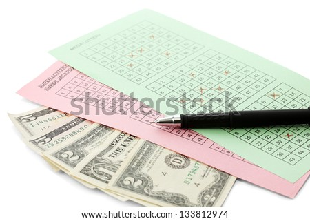 Lottery tickets with pen and money, isolated on white