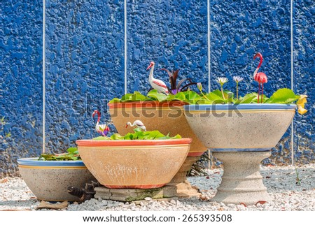 Lotus and big jar in stone garden - stock photo