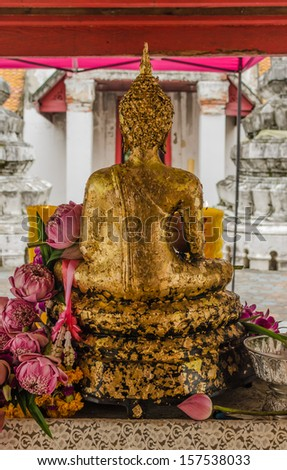 Lotus in hand image of buddha - back view