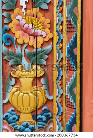Lotus in vase carved colorful paint on temple door - stock photo