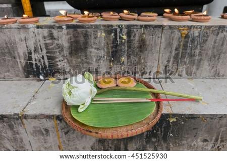 Lotus, incense sticks and candles set for praying Buddha at temple - stock photo