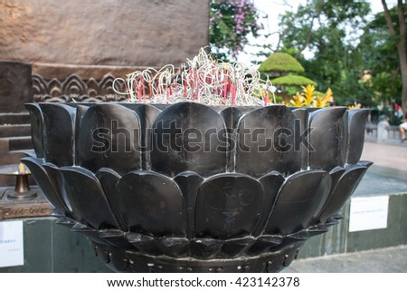 lotus shaped incense burner in Ly Thai To statue in Hanoi Vietnam - stock photo