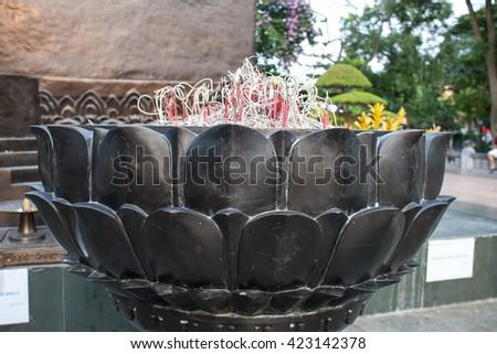lotus shaped incense burner in Ly Thai To statue in Hanoi Vietnam - stock photo