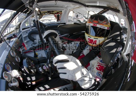 LOUDON, NH - SEP 19:  Greg Biffle straps into his 3M/Scotch Ford for the final practice session for the Sylvania 300 at the New Hampshire International Speedway on Sep 19, 2009 in Loudon, NH - stock photo
