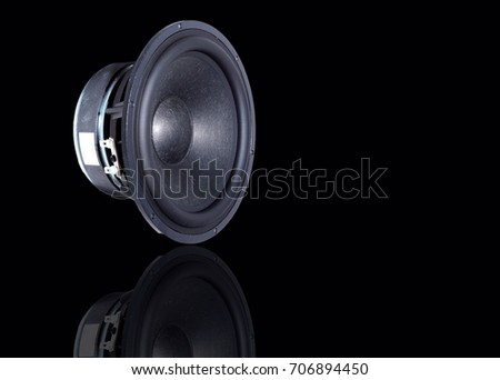 Loudspeaker separated from the black background.
